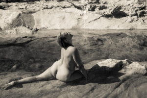 woman sitting in water, looking up