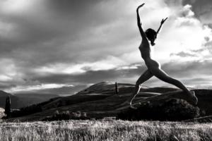woman joyfully leaping