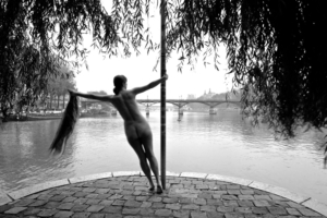 nude woman overlooking a bridge, black and white photo