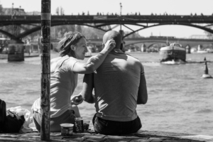 christine spring photography - a couple sitting on a dock
