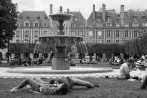 christine spring photography - people laying by a fountain